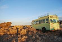 Abandoned Green School Bus In Desert