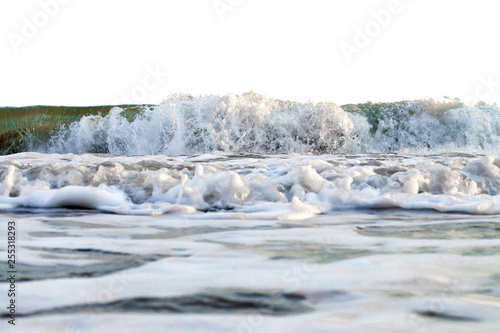 Fotografiet  powerful  foamy wave runs in a coast