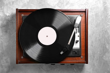 Record Player With Vinyl Disc On Grey Background