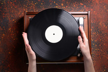 Female Hands With Vinyl Disc A...