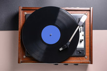 Record Player With Vinyl Disc On Table