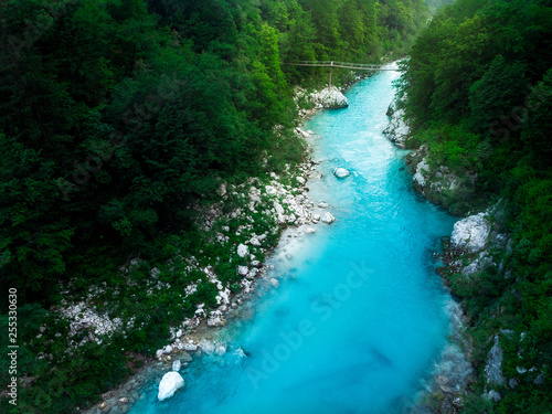 Aluminium Prints Forest river Turquoise Soca river flows in wild forest