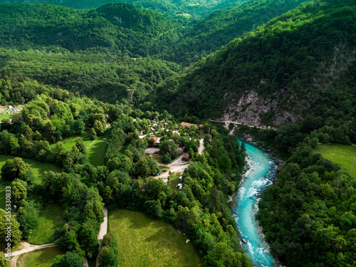 Aluminium Prints Forest river Soca river valley in green spring forest,aerial view