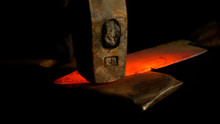 MACRO, DOF: Stunning Shot Of Hot Piece Of Metal Held By Tongs And Hit By Hammer