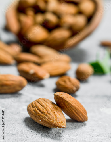 Almonds with green leaves . Wallpaper Mural