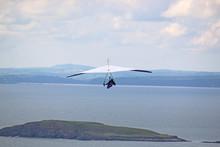 Hang Glider Flying At Rhossili, Wales