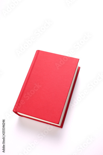 Fotografia  red book isolated on white background with copy space for your text clipping pat