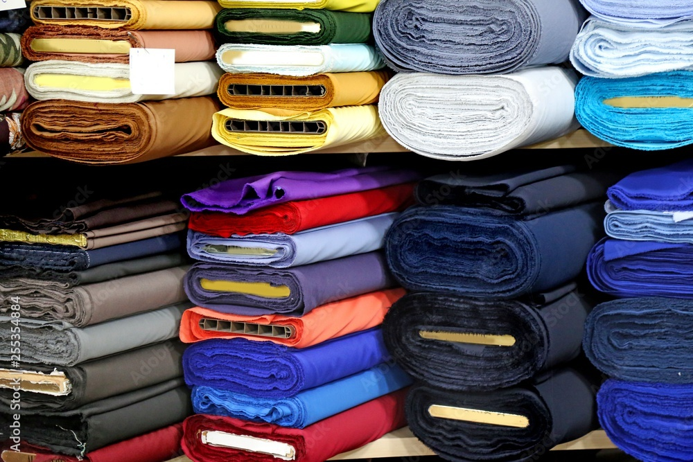 Fototapety, obrazy: Shelf with a wide selection of colorful fabrics
