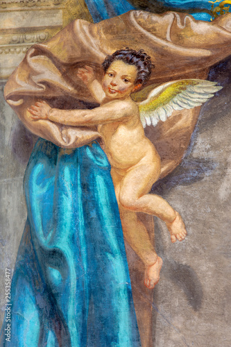 PARMA, ITALY - APRIL 17, 2018: The detail of baroque angels with the drapery fresco in church Chiesa di San Bartolomeo from 17. cent.