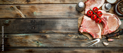 Raw pork steaks with tomatoes and spices. - 255361841
