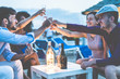 canvas print picture Group of young tourist friends cheering with champagne at beach party - Focus on hands glasses