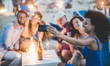 canvas print picture Happy friends taking selfie with smartphone at beach party outdoor - Young people having fun together at bar drinking champagne  - Focus on african girl hand phone - Youth and summer concept