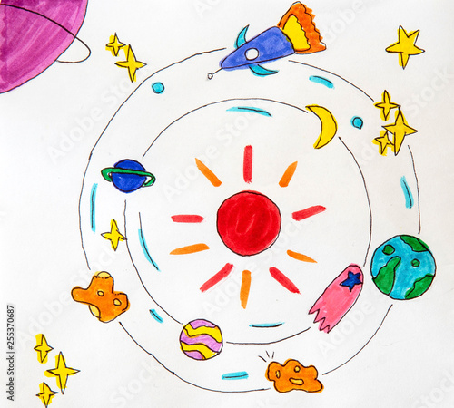 Photo  children's drawing is painted with colored pens of aliens, stars, planets and co