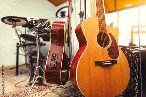 group home rehearsal room with guitars - 255377613