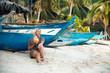 Blond Woman Sit on Beach Drink Coconut Juice
