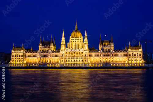 Fotografie, Obraz  Illuminated Budapest parliament building at night with dark sky and reflection i