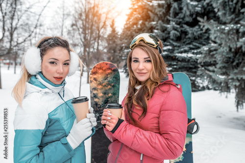 Fotografie, Obraz  Girls girlfriends in winter in woods for the weekend rest in the resort