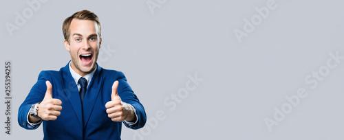 Obraz businessman with thumbs up gesture - fototapety do salonu