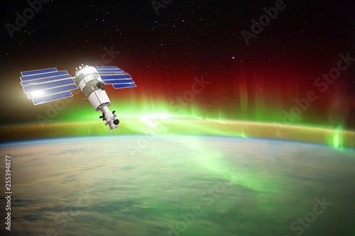 Vászonkép Satellite for observing aurora borealis in Earth orbit, measuring the flow of sun particles, the solar wind