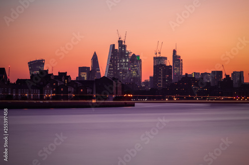 Fotografie, Obraz  Illuminated London cityscape with beautiful sunset