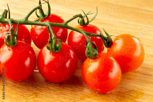 Fotografie, Obraz  Close up of wet cherry tomatoes with big green pedicels