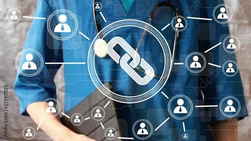 Fotografia  Doctor pushing button link virtual healthcare network on virtual medical panel