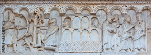 MODENA, ITALY - APRIL 14, 2018: The romanesque relief of Kain and Abel from paradise on the facade of Duomo di Modena.