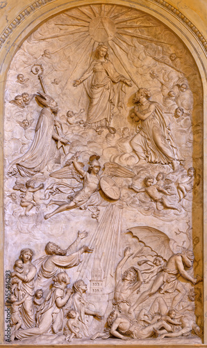 REGGIO EMILIA, ITALY - APRIL 14, 2018: The relief of Virgin Mary among the saints in church chiesa di San Francesco by unknown artist.