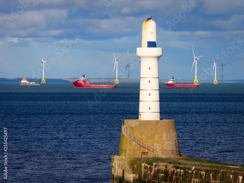 Valokuva Lighthouse and Waiting Ships among wind turbines