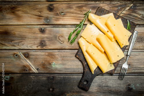 Fototapeta Thin slices of rosemary cheese. obraz