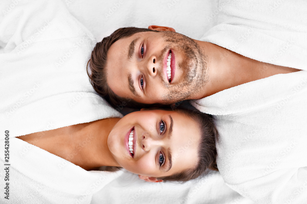 Fototapeta Adult happy couple relaxing in spa salon