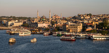 Evening View Of The Golden Horn Bay With The Eminonu Pier In The Foreground.