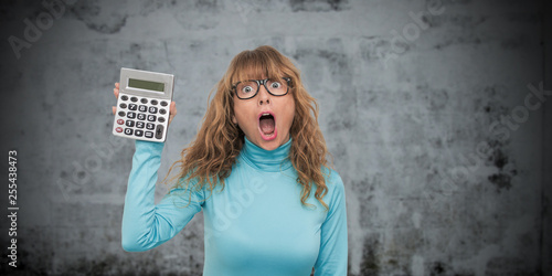 Photo sur Toile Kiev isolated woman with calculator astonished with surprise