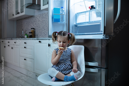 Photo  Girl Eating Cupcake Sitting In Front Of Open Refrigerator