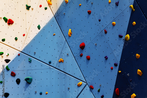 Obraz na plátně Close-up of climbing exercise wall with grips