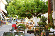 canvas print picture - Small outdoor restaurants at the pedestrian area at center of Kalavryta town near the square and odontotos train station, Greece.