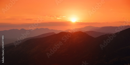 Foto auf Leinwand Braun Beautiful sunset colors over the mountains of Peloponnese, Greece.