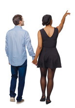 Back View Of Interracial Going Couple Who Points Somewhere.