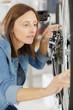 female bicycle mechanic repairing wheel in a workshop