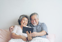 Senior Couple Using A Tablet P...