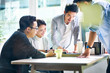 group of four asian business people working together in office