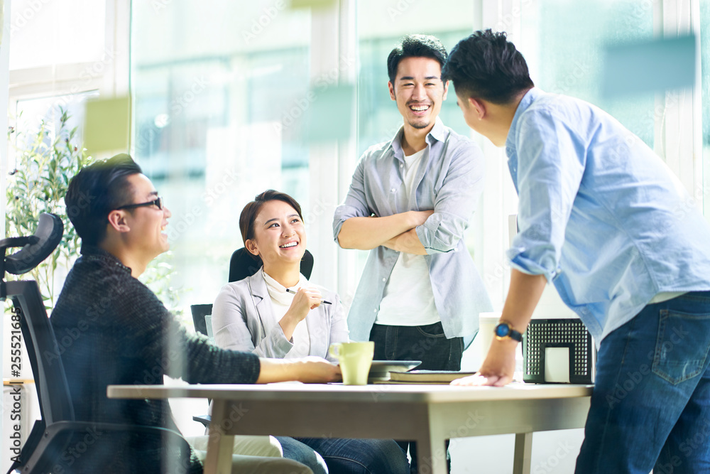 Fototapeta happy asian business team meeting in office