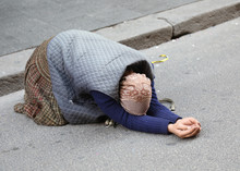 Elderly Gypsy Woman Begging For Passersby Kneeling With Her Hand