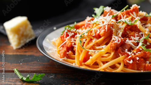 Spaghetti alla Amatriciana with pancetta bacon, tomatoes and pecorino cheese - 255534476