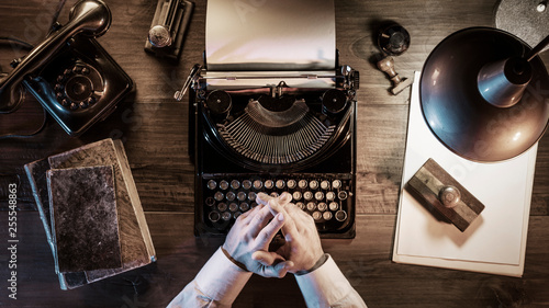 Journalist working in his vintage office at night Canvas Print
