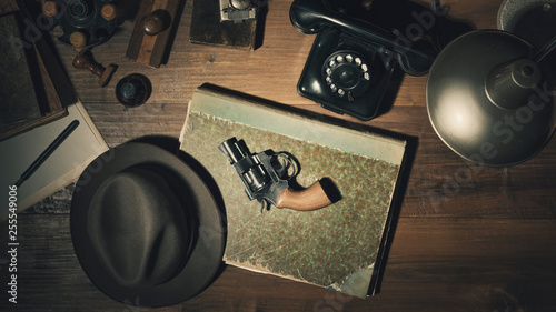 Noir 1950s style detective desktop with revolver Canvas Print