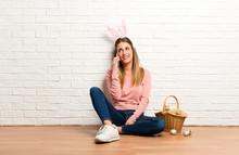 Young Woman Wearing Bunny Ears...