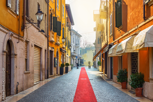 Fotobehang Zuid-Amerika land Street with red pathway in old town of Peschiera Del Garda, province of Verona, Italy. Architecture and landmark of Peschiera Del Garda.