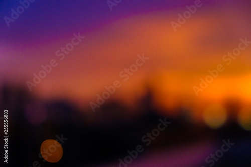 Montage in der Fensternische Hochrote Colorful blurred sky sunset silhouette city building