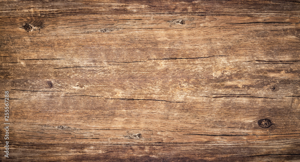 Fototapeta Wood texture background. Surface of old knotted wood with nature color, texture and pattern. Top view of weathered vintage wooden table with cracks. Brown rustic rough wood for backdrop.